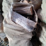 Hessian sack full of logs