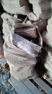 Hessian sack full of logs